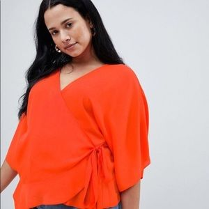 Orange kimono sleeve wrap top